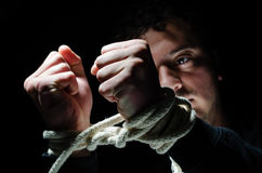 Captive. Hands tied up with rope Stock Photography