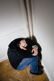 Captive. Victim male is having his hand tight with chains Royalty Free Stock Image