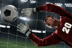 Captura del portero del fútbol la bola Imagen de archivo