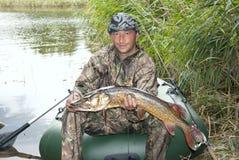 A captura do pescador fotos de stock
