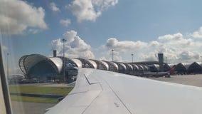Captura en el avión en el aeropuerto Tailandia del suwannaphum foto de archivo