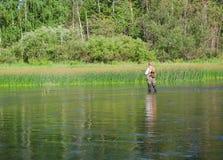 Capturas do pescador da pesca com mosca do caboz Fotos de Stock