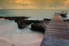 Capture of a boat on a tropical island beach Stock Photos