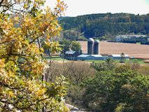 A Valley Farm in Wisconsin. A capture of the changing leaves and drying corn in rural Dane County Wisconsin. This early fall scene was taken on a warm afternoon stock photography