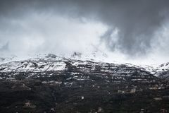Beautiful capture of a mountain covered with snow royalty free stock photography