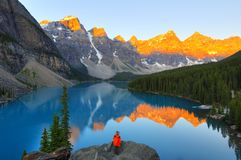 Capture the light. Photographer watchs the amazing view of Lake Moraine, Banff, Canada Stock Photo