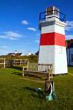 Capture of lighthouse with wooden seat Stock Photography