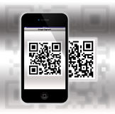 Capture a QR ( Quick Response ) Code. An image showing a super mobile phone with a scan of a QR (Quick Response Code) on the screen and a blurred version in the Stock Images