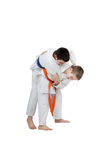 Capture for throw is performing athlete  with orange belt. Capture for throw is performing athlete Stock Images