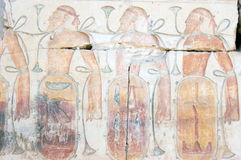 Captured Asyrians Hieroglyphic carving. An ancient egyptian painted hieroglyphic carving showing defeated Asyrian soldiers, bound and lashed together. Ancient stock photo