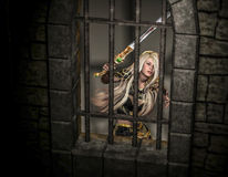 Captured. 3d rendering of a female warrior trapped in a fortress as illustration Royalty Free Stock Photography