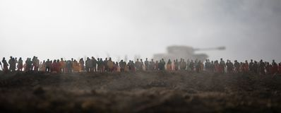 Captured by enemy concept. Military silhouettes and crowd on war fog sky background. World War Soldiers and armored vehicles. Movement while scared people stock image