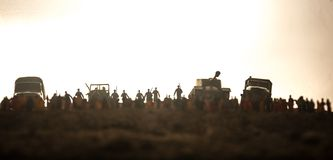 Captured by enemy concept. Military silhouettes and crowd on war fog sky background. World War Soldiers and armored vehicles. Movement while scared people stock images