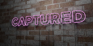 CAPTURED - Glowing Neon Sign on stonework wall - 3D rendered royalty free stock illustration Royalty Free Stock Image
