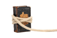 Captured old book. Very old book captured with rope isolated on white Royalty Free Stock Images