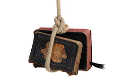 Captured old books. Captured two very old books with rope isolated on white stock photography