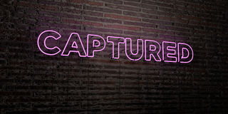 CAPTURED -Realistic Neon Sign on Brick Wall background - 3D rendered royalty free stock image Royalty Free Stock Images