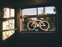 Sticker of a bike on a train window. Captured in a swiss regional train. the place where bike may be stored in trains royalty free stock photo