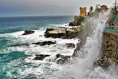 Waves crashing against the sea walls of Nirva, Genoa, Liguria, Italy. stock photography