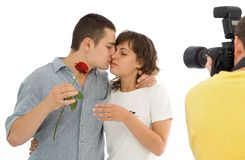 Capturing love. Photographer trying to capture the essence of love - isolated Stock Photo