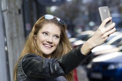 Capturing the moment with a smartphone Royalty Free Stock Image