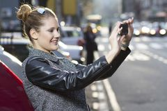 Capturing the moment with a smartphone Royalty Free Stock Photo