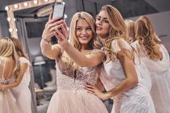 Capturing the moment. Young beautiful women in amazing wedding d Royalty Free Stock Image