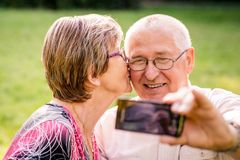 Capturing moments - senior couple Royalty Free Stock Image