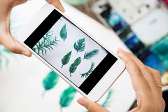 Capturing a painting photo, green leaves by mobile phone.  Royalty Free Stock Photos