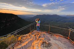 Capturing a photo of sunrise mountain lookout Royalty Free Stock Photography