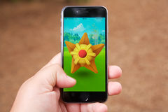 Capturing a Pokemon while playing Pokemon Go Royalty Free Stock Photography