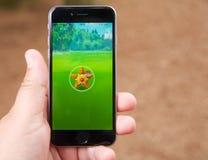 Capturing a Pokemon while playing Pokemon Go Royalty Free Stock Photo