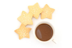 Capuccino coffee in vintage style cup and star cookie in coffee Royalty Free Stock Photos