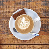 Capuccino cup on wooden background Stock Photos