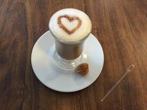 Capuccino with heart above foam. Picure of a capuccino or coffee made with a heart above foam that also can represent a drink made with love Stock Photos
