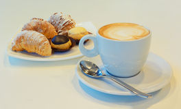 Capuccino and pastries Stock Photos