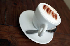 CAPUCHINO CUP. On a table Stock Image