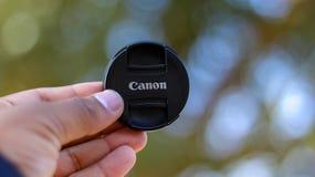 Capuchon d'objectif de Canon photographie stock