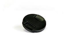 Capuchon d'objectif noir Photos stock