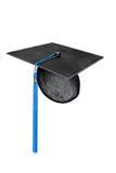 Capuchon de graduation avec le gland bleu image libre de droits