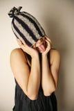 Capuchon s'usant de fille asiatique Photographie stock libre de droits