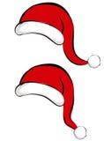 Capuchons de Santa Photo stock