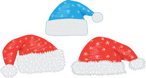 Capuchons de Santa de Noël Photographie stock libre de droits