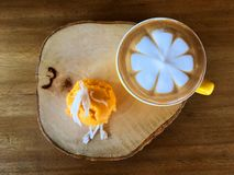 Capucino coffee with toddy palm cake thai dessert on wooden table stock images