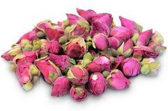Capullos de rosa secados en un blanco. foto de archivo
