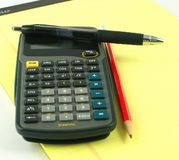 Caqlculator. Calculator with pad of paper and pens Royalty Free Stock Image