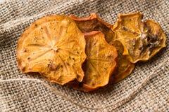 Caqui secado Kaki Fruit Slices/fecha seca de Trebisonda Fotos de archivo
