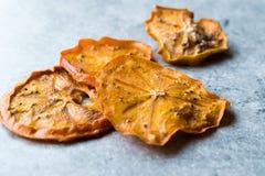 Caqui secado Kaki Fruit Slices/fecha seca de Trebisonda Imagen de archivo