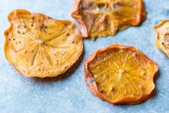 Caqui secado Kaki Fruit Slices/fecha seca de Trebisonda Foto de archivo