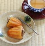 Caquis secados japoneses, dulces japoneses Imágenes de archivo libres de regalías